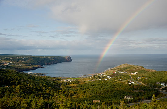 A rainbow materializes out of a passing squall over Flatrock.