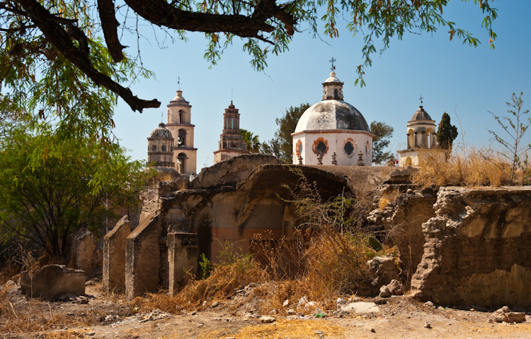 The Santuario of Atotonilco behind ruins from another time.